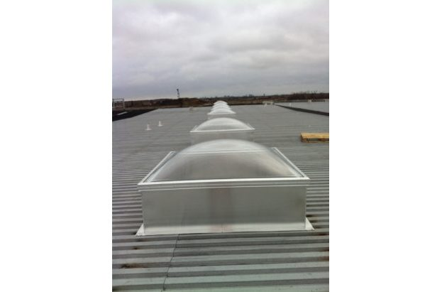 Clear Acrylic Dome Skylight with Frost Free Frames on an Aluminum Curb