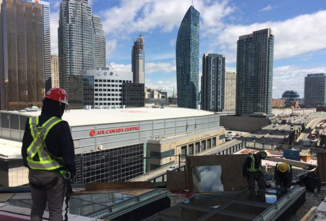 Skylight installation with view of Toronto