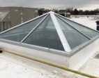 Pyramid skylight on a reflective roof
