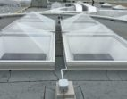 Thermoformed Acrylic pyramid skylight with aluminum curbs