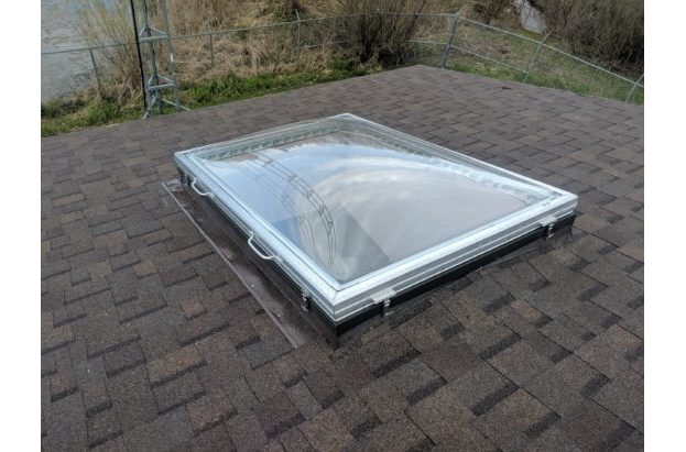 Removable Skylight with Clear Acrylic Domes on a Sloped Shingle Roof