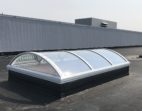 Architectural Continuous Barrel Vault Acrylic Skylight on a Flat Roof