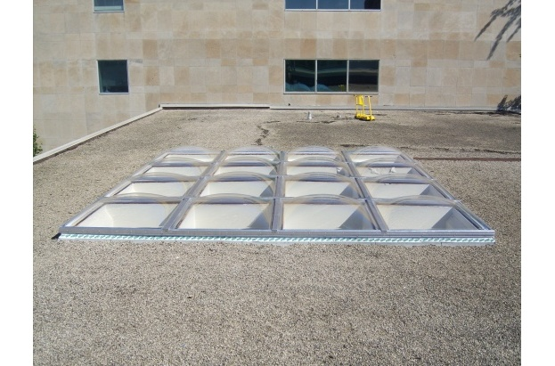 Clear Acrylic Butted Domes on Flat Ballast Roof